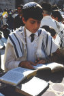 Israel Jerusalem boy wearing tefellin praying at his Bar mitzvah at the Western Wall