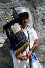 Israel Jerusalem Sephardic Jewish boy at his Bar mitzvah ceremony holding the Torah