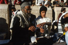 Israel Jerusalem Sephardic Rabbi helping boy put on the tefillin at his Bar mitzvah