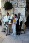 Israel Jerusalem Sephardic Rabbi withfather and son holding Torah at his Bar mitzvah