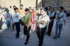 Israel Jerusalem Sephardic Rabbi with  boy carrying the Torah at his Bar mitzvah ceremony