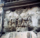 Romans carrying the menorah captured from Jerusalem, marble relief, Arch of Titus, circa 82 AD, Roman Forum, Rome, Italy
