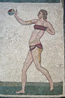 Girl gymnast playing handball in a bikini, fourth century Roman Villa del Casale, near Piazza Armerina, Sicily, Italy