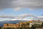 Taormina, view of town with Mount Etna in the background, Sicily, Italy