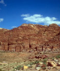 Urn tomb, centre, and other other royal tombs carved in west face of Al-Khubtha mountain, Petra, Jordan
