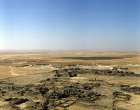 Umm el-Jimal, originally Nabataean city, taken over by Romans, Byzantines, Umayyads and Abbasids, built of black basalt, aerial, north Jordan