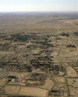 Umm al-Jimal, originally Nabataean city, taken over by Romans, Byzantines Umayyads and Abbasids, built of black basalt, aerial, north Jordan