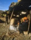 Bedouin woman preparing fire in clay oven