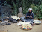Bedouin woman making unleavened bread (shrak), Jordan