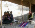 Bedouin woman weaving rug in her tent near Petra, Jordan