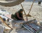 Bdoul Bedouin woman weaving rug near Petra, Jordan