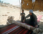 Bedouin woman weaving a rug, Jordan