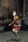 Masked dancer in Bhotebahal courtyard, Kathmandu, Nepal