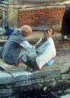 Barber at work, Nepal