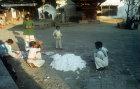 Children beating kapok, Nepal
