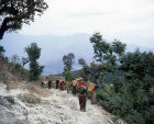 Women carrying loaded baskets, Pokhara, Nepal