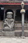 Guardian statue in front of Dattatreya Temple, Durbar Square, Bhaktapur, Nepal