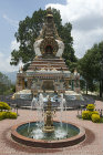Shrine and fountain in garden of Kopan Tibetan Buddhist Monastery, Kathmandu, Nepal
