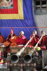 Tibetans blowing long horns, Tiji Festival, Lomanthang, Upper Mustang, Nepal