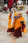 Two saffron-robed dancers, Tiji Festival, Lomanthang, Upper Mustang, Nepal