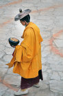 Saffron-robed participant in Tiji Festival, Lomanthang, Upper Mustang, Nepal