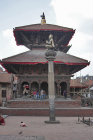 Column with figure of man bird god Garuda, Durbar Square, Patan, Nepal