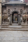 Animal figures guarding entrance to shrine, Durbar Square, Patan, Nepal