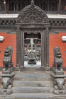Lion sculptures guarding temple, Uku Bahal, Patan, Nepal