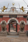 Lions guarding entrance to shrine, Mahavihar temple, Patan, Nepal