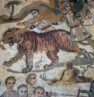 Tigress being captured for Roman games, third to fourth century Roman floor mosaic in imperial villa at Piazza Armerina, Sicily