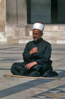 Syria, Aleppo, blind man praying in courtyard of the Great Mosque