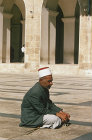 Syria, Aleppo, a blind man praying in the courtyard of the Great Mosque