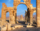Triumphal arch and ruins at sunrise, Palmyra, Syria