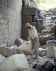 Syria, Aleppo, stone worker inside the citadel
