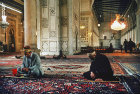 Omayyad Mosque which dates from eighth century, two muslims praying, Damascus, Syria
