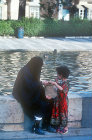 Syria, Damascus, woman and child by pool of the Tekkiye Mosque
