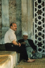 Syria, Damascus, two men sitting outside the Tekkiye Mosque