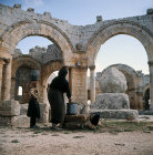 Syria,  Qalaat Semaan, women drawing water near Saint Simeons pillar in the monastery
