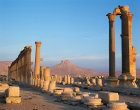 Syria, Palmyra, sunrise over ruins looking towards the 16th century Arab castle