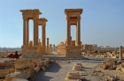 Tetrapylon, view east along colonnaded street to monumental arch, Palmyra, Syria