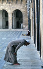 Syria, Aleppo, man praying in the courtyard of the Great Mosque