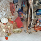 Berber women working at the loom and pounding henna, Island of Djerba, Tunisia