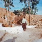 Berber Troglodyte woman and dwelling, Matmata, Tunisia