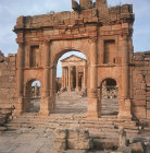 Arch of Antoninus Pius, Temple of Jupiter and Juno behind, 138-61 AD, Sufetula, Tunisia