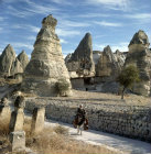 Cone dwellings at Macan, and farmer on donkey, Cappadocia, Turkey