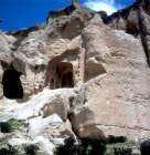 Turkey, Cappadocia, where the rock face has fallen away on the right is the escape chimney from the church and on the left is a monastic cell