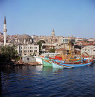 Galata tower, built 1348, Sokollu Mehmet Pasha Mosque built by Sinan, 16th century and Black Sea fishing boats, Istanbul, Turkey