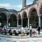 Young Turks at ablutions fountain, Uc Serefeli Mosque, Edirne, Turkey