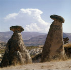 Turkey, Cappadocia, on the road between Urgup and  the Goreme Valley, two eroded Tufa Cones capped with hard rock