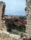Basilica, fifth century, seen through hexagonal built wall, Kanytelis, ancient city near Elaiussa Sebaste on south east coast of Turkey